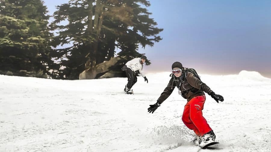 Two backcountry snowboarders
